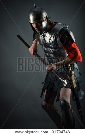 brutal warrior in armor with a spear in hands