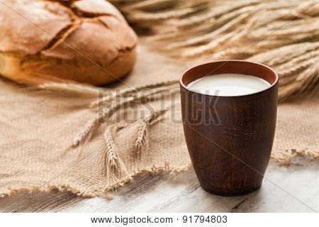 Cup Of Milk On Background Ears Rye And Bread.