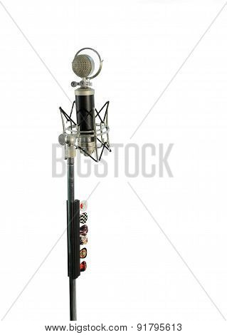 Vocal condenser microphone with wind screen isolated on white background.