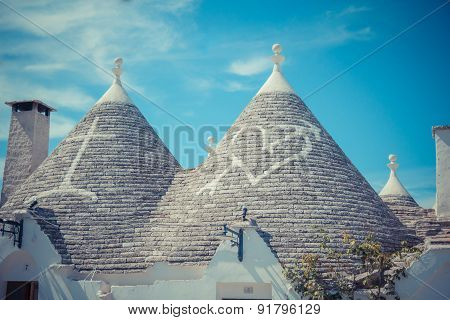 Close up of a conical roofs of a Trulli houses with painted symbols