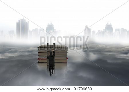 Business Man Climbing On Wooden Ladder To Top Of Books