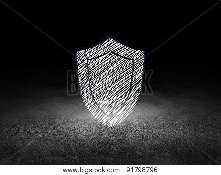 Security concept: Shield in grunge dark room