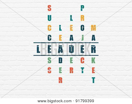 Business concept: word Leader in solving Crossword Puzzle