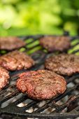 picture of beef-burger  - Tasty beef burgers on the grill - JPG