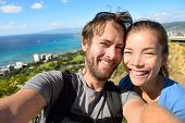 stock photo of waikiki  - Selfie couple travel fun  - JPG