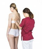image of physiotherapist  - physiotherapist doing a physical examination of a woman - JPG