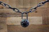 picture of combinations  - Combination lock and chain on a rustic wooden background - JPG