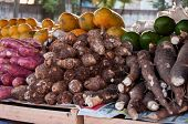 picture of root vegetables  - Taro Roots and Other Vegetables for Sale in Brazilian Street Market. ** Note: Shallow depth of field - JPG