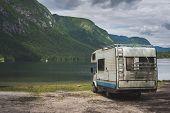 image of camper-van  - Camper van parked on a beach, mountain range landscape  - JPG