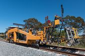 image of railroad yard  - Machine used on railroads for maintenance tasks