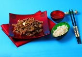 stock photo of stir fry  - Vietnamese beef stir fry served on a blue background - JPG