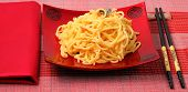 stock photo of carbonara  - spaghetti carbonara served on a bamboo place mat - JPG