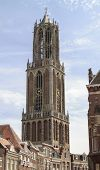 pic of dom  - Ancient Dom cathedral towering above the traditional houses in the city center of Utrecht - JPG