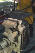 pic of blacksmith shop  - Vise and anvil in a forge shop - JPG