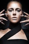 pic of black eyes  - Beautiful girl with creative makeup in Gothic style and the threads of eyes - JPG