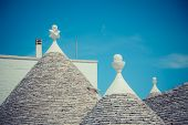 picture of conic  - Close up of a conical roofs of a Trulli houses in the southern Italian town of Alberobello - JPG