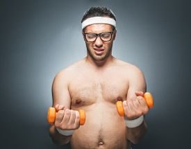 foto of nacked  - Lazy man try to exercising and doing fitness - JPG