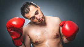 foto of knockout  - Close up of knockout boxer over dark gray background - JPG