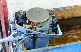 stock photo of outboard engine  - a test of small motor of outboard - JPG