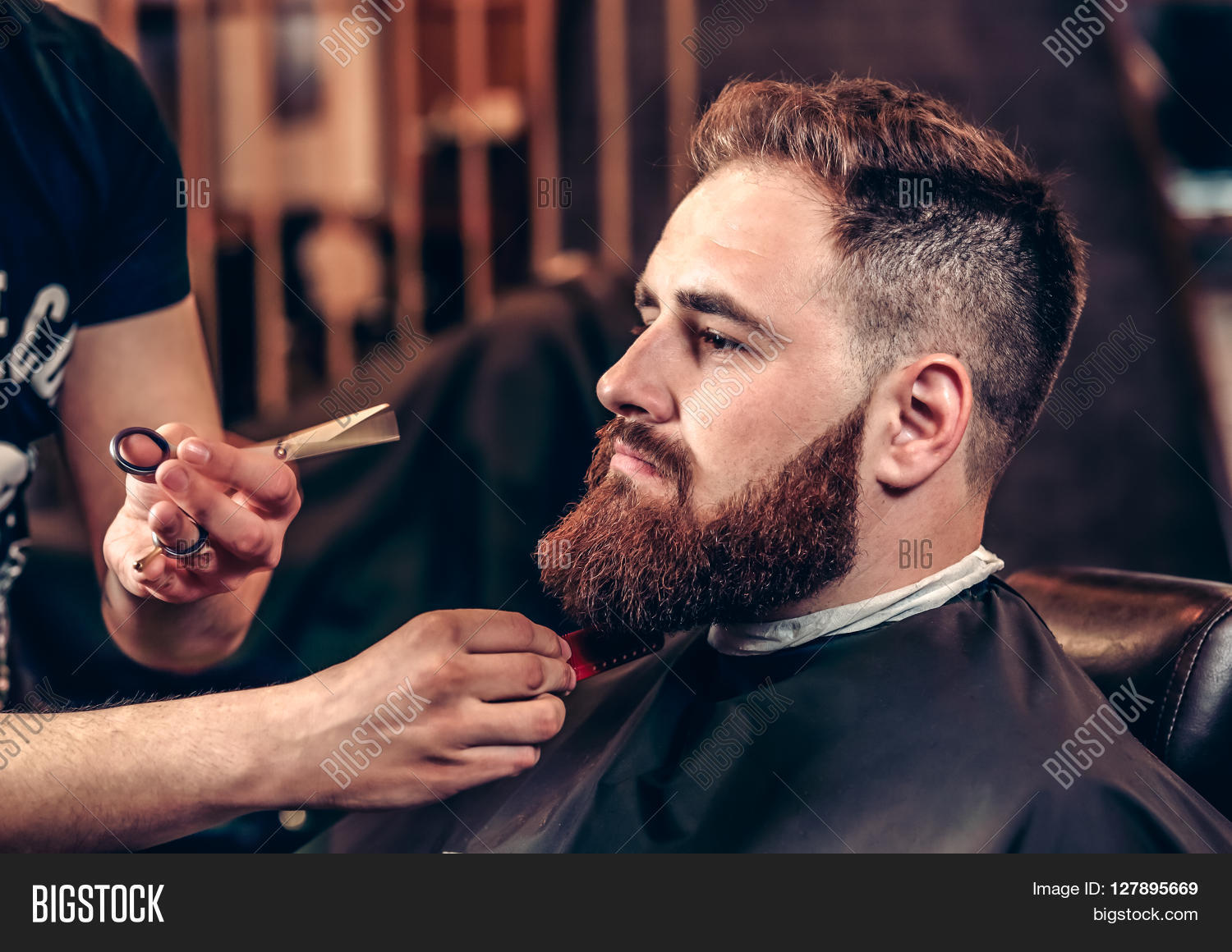 closeup professional grooming beard with scissors in a barbershop portrait of a bearded man. Black Bedroom Furniture Sets. Home Design Ideas