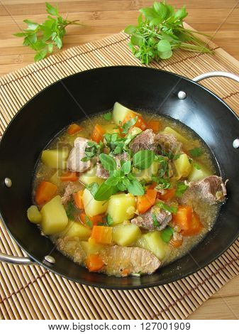 Wok goulash with vegetables and fresh herbs