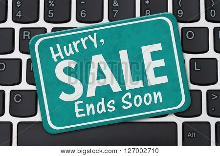Hurry Sale Ends Soon Sign A teal sign with text Hurry Sale Ends Soon on a keyboard