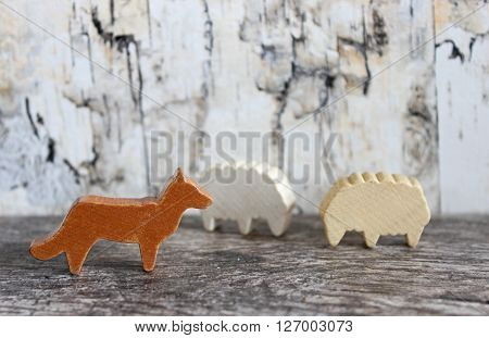 Wood wolf and two sheep against birch background concept image