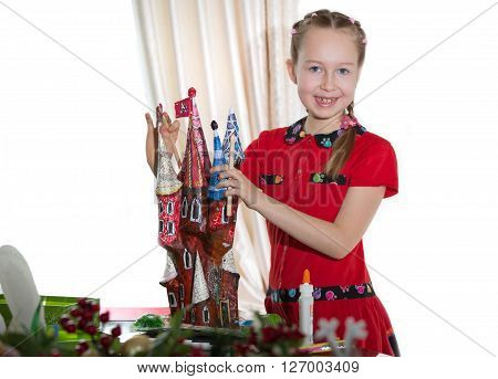 Little girl demonstrating her art craft works, Paper masher fairy castle. Educational and creative concept.