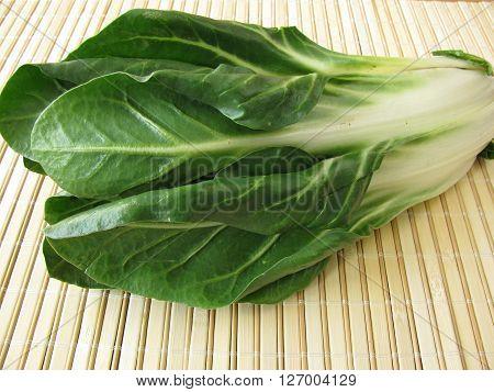 Fresh green chard leaves on cutting board