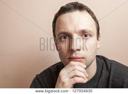 Young Serious Man, Closeup Studio Portrait