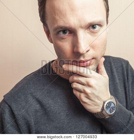 Thinking Handsome Caucasian Man, Studio Portrait