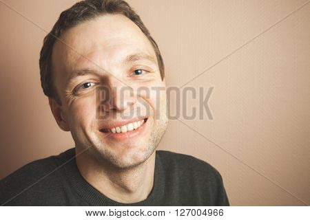 Young Handsome Smiling Man Studio Portrait