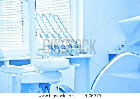 Professional Dentist tools in the dental office. Dental Hygiene and Health conceptual image. Blue image.