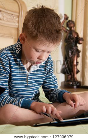 boy sitting on the bed in the background for your tablet statuette