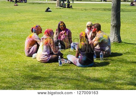 London Ontario, Canada - April 16: Unidentified Young Colorful People Talking In Circle On The Grass