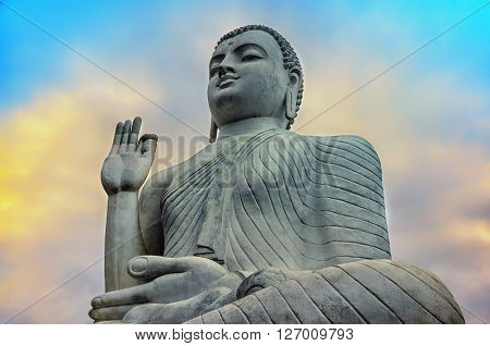 Buddha statue in blue sky.Sri Lanka Buddha.Buddha in a dramatic sky background.