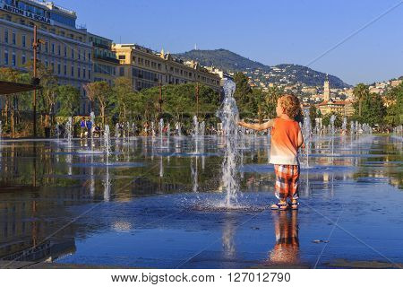 Nice, France - May 18: This is fountain on the Promenade du Payon at the center of the city in the hours of sunset May 18, 2015 in Nice, France.