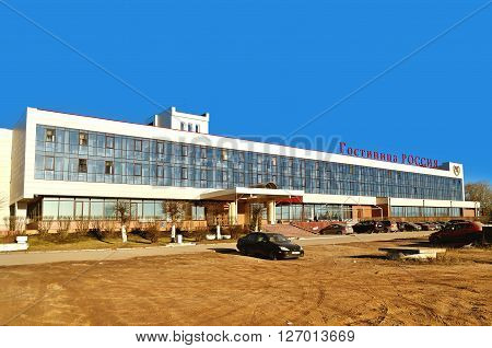 VELIKY NOVGOROD RUSSIA - MARCH 14 2015. Facade of two-star Rossiya hotel at spring evening in Veliky Novgorod Russia