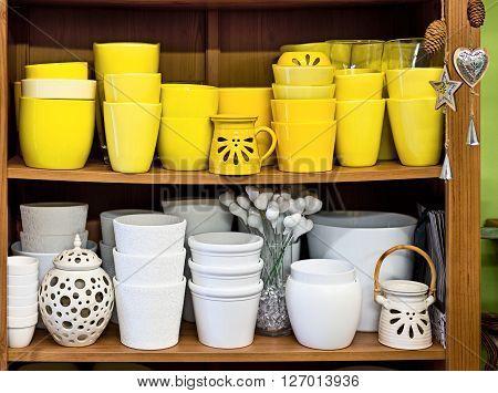 new ceramic flowerpots in the florist store