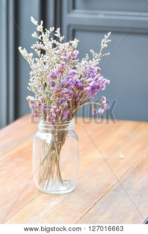statice flowers in a vase blur background