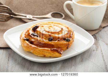 fresh danish pastry with raisins and coffee
