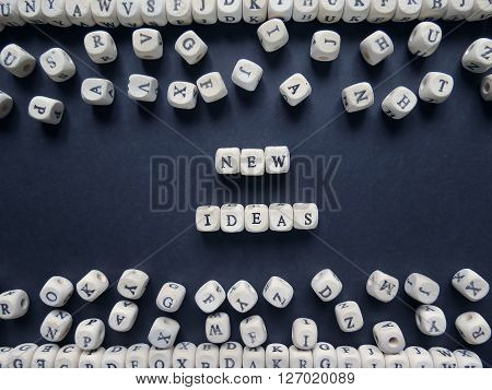 Word New Ideas Of Small White Cubes Next To A Bunch Of Other Letters On The Surface Of The Compositi