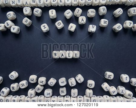Word Sale Of Small White Cubes Next To A Bunch Of Other Letters On The Surface Of The Composition On