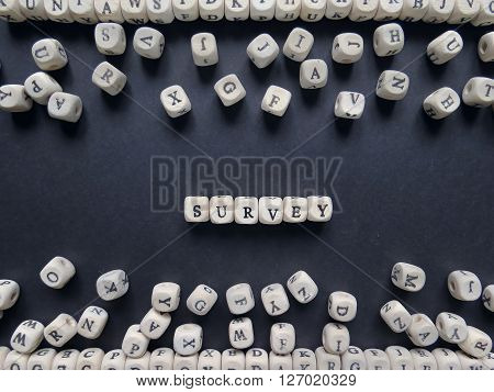 Word Survey Of Small White Cubes Next To A Bunch Of Other Letters On The Surface Of The Composition