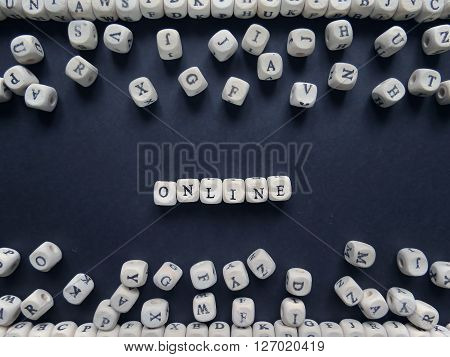Word Online Of Small White Cubes Next To A Bunch Of Other Letters On The Surface Of The Composition