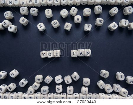 Words You Can Of Small White Cubes Next To A Bunch Of Other Letters On The Surface Of The Compositio