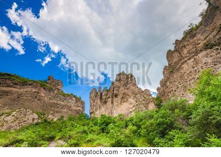 View on mountain cliffs and magnificent cloudy sky on background. Exploring Armenia