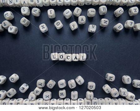 Word Local Of Small White Cubes Next To A Bunch Of Other Letters On The Surface Of The Composition O