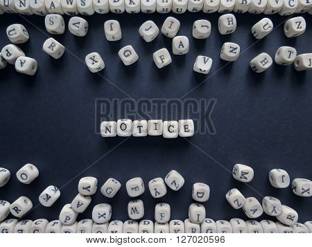 Word Notice Of Small White Cubes Next To A Bunch Of Other Letters On The Surface Of The Composition