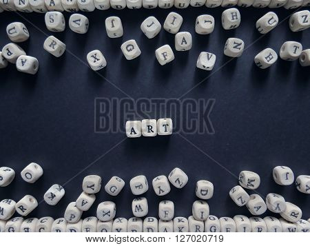 Word Art Of Small White Cubes Next To A Bunch Of Other Letters On The Surface Of The Composition On